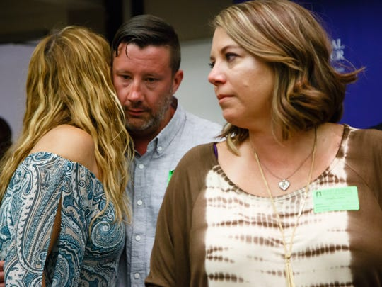 Girl Scouts bus crach survivor Tracie Schiebel Keller embraces Jeff Barnum, whose sister, Jennifer Barnum, died in the crash, at the 25th Anniversary Dedication Event, Monday, August 1, 2016.