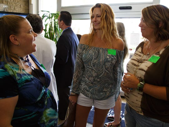 Kate Lucas , Tracie Schiebel Keller, and Jamie Harriott (left to right) survivors of the Girl Scouts bus crash catch up before the 25th Anniversary Dedication Event held at Desert Regional Medical Center, Monday, August 1, 2016.