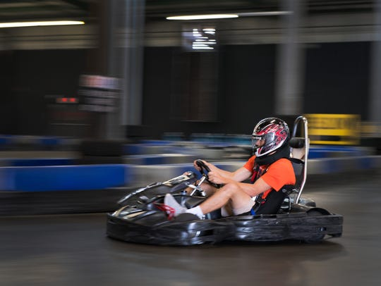 A racer moves through the LeMans Karting track. The