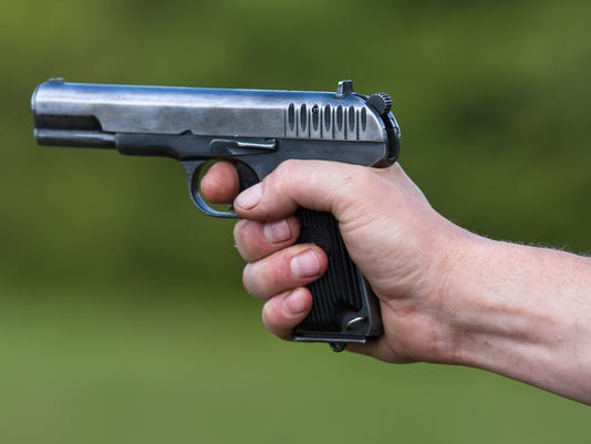the TT pistol in hand