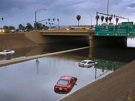 Cars sit stranded in flood waters along Interstate