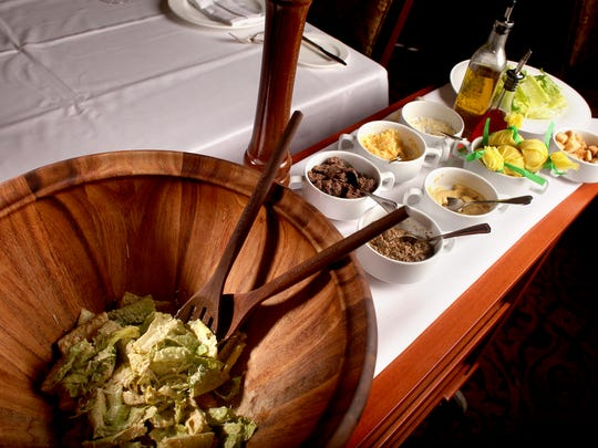 The tableside Caesar salad at the English Grill.