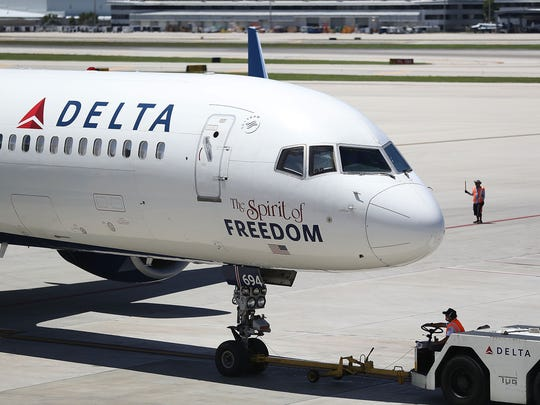 A Delta airlines plane is seen on the tarmac of the
