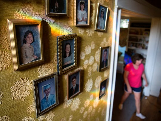 Photos of some of 92-year-old Margaret Coleman's 48 grandchildren hang on the wall of the Coleman family home Monday, July 25 in Chicago. Margaret and her husband John Coleman had 14 children together. (Erin Hooley/Chicago Tribune/TNS)