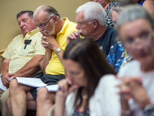 Charles Winschuh, of Dimock Township, second from left, was among the concerned citizens who packed Wednesday's Susquehanna County commissioner's meeting to express misgivings about a proposed incinerator project.