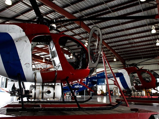 Helicopters equipped with pesticide spraying modules for Collier Mosquito Control in May 2012.