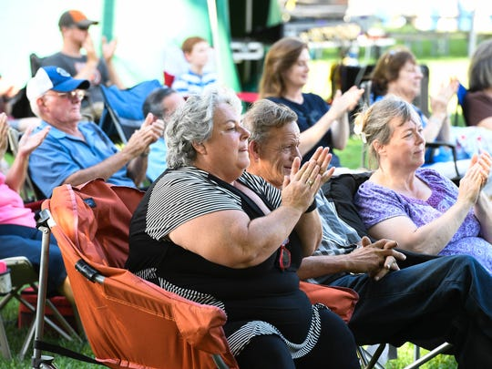 MIKE LAWRENCE / THE GLEANERBluegrass fans applaud between songs during a set for the local band Kings Highway during the 31st annual Bluegrass in the Park/Folklife Festival in Henderson's Audubon Mill Park Friday, August 12, 2016.