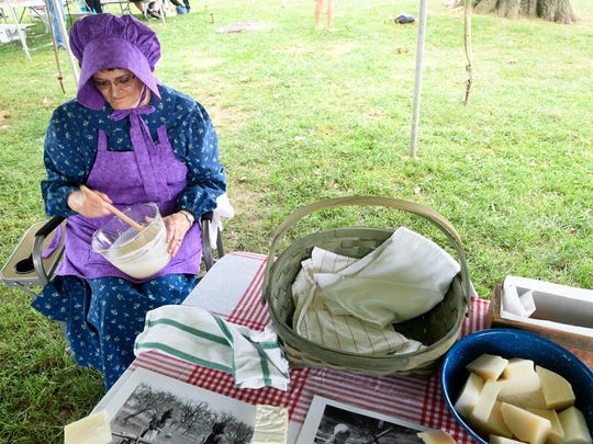 Soap maker Lucia Felty makes a batch of traditional soap using hog and beef fat along with lye at the Henderson Bluegrass in the Park Folklife festival last year.