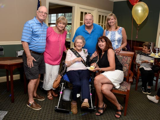 Celebrating her 100th birthday, Anne LaHoff (seated) visits with family members (from left) Robert and Eva Miller, Michael Miller, Maureen Stivale and Elaine Miller.