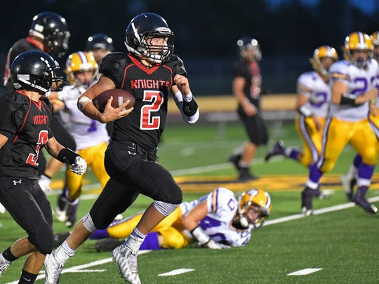 Lourdes Academy's Sawyer McCue (2) breaks free for a 54-yard run just before halftime on Thursday night against Wild Rose.