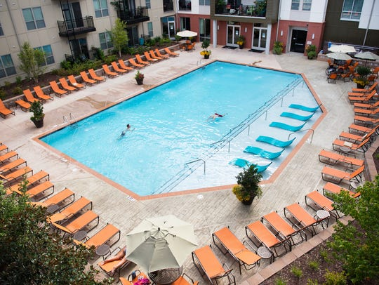 South Ridge Apartments residents swim in the pool on