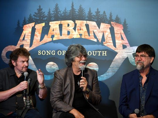 """Jeff Cook, left, Randy Owen and Teddy Gentry of Alabama speak during the debut of the """"Alabama: Song of the South"""" exhibition Aug. 22, 2016, at the Country Music Hall of Fame and Museum."""