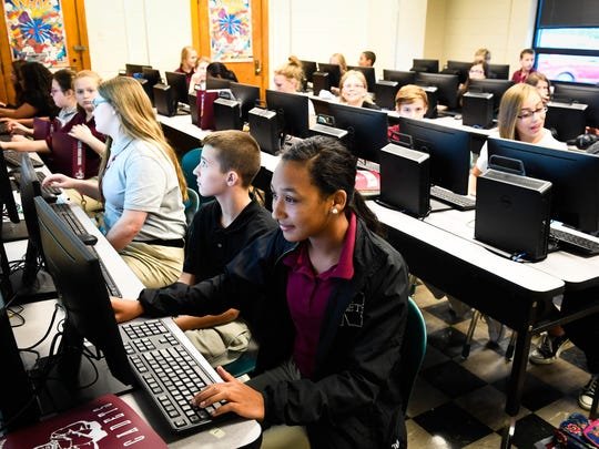 Emma Amstead (foreground) uses a computer running Windows 10  in a class exercise for a Careers class at Henderson's North Middle School Tuesday. Henderson County Schools had the largest computer upgrade in the state with nearly 5,000 computers affected.