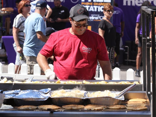 John Rapchick, of Macomb, MI, cooks pierogi in the Srodek's Polish Kitchen booth during opening day of the Arts, Beats & Eats festival in Royal Oak on Friday, September 2, 2016.