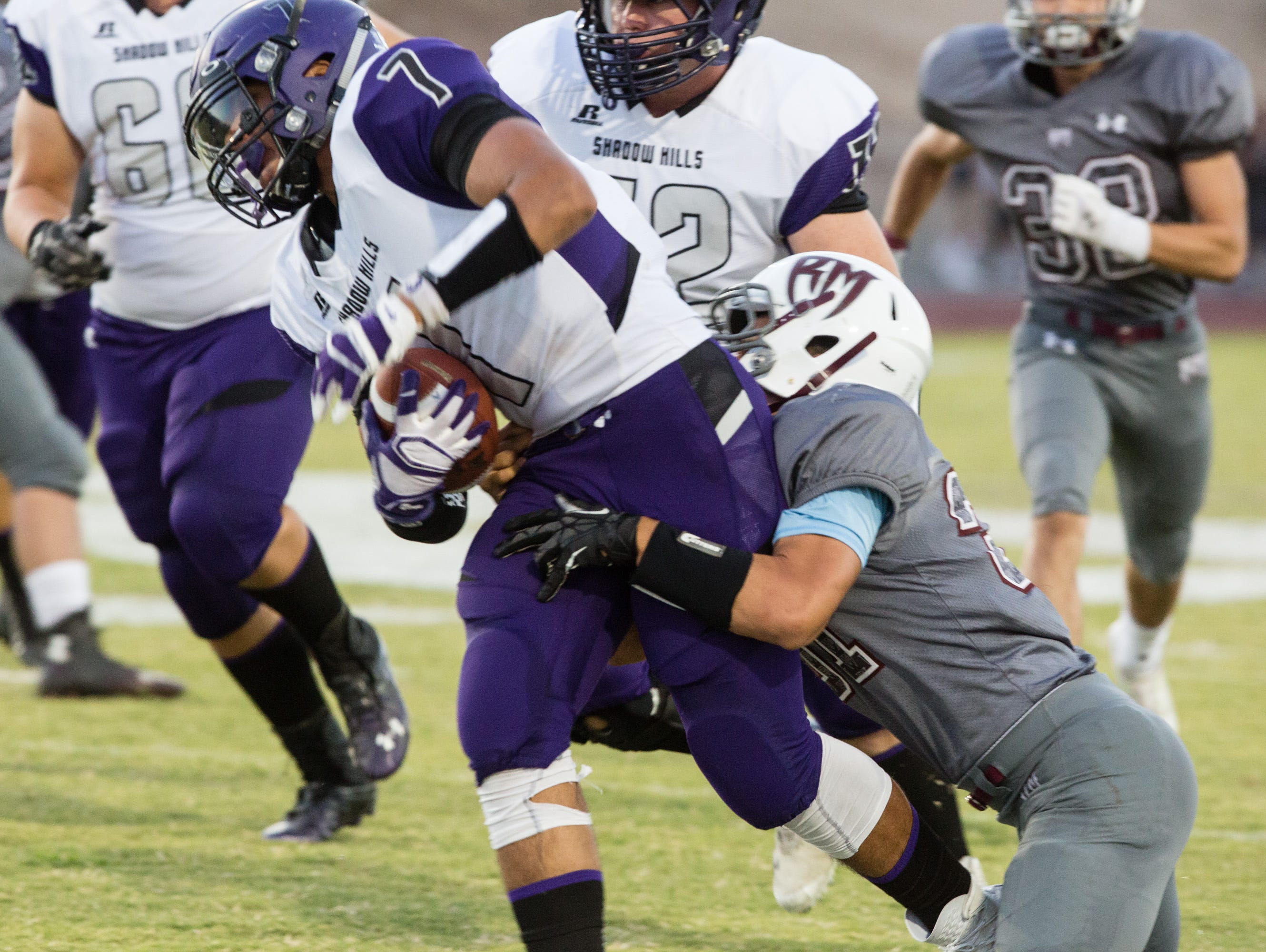 Sammy Venegas carries the ball for Shadow Hills, Friday, Sept. 2, 2016.