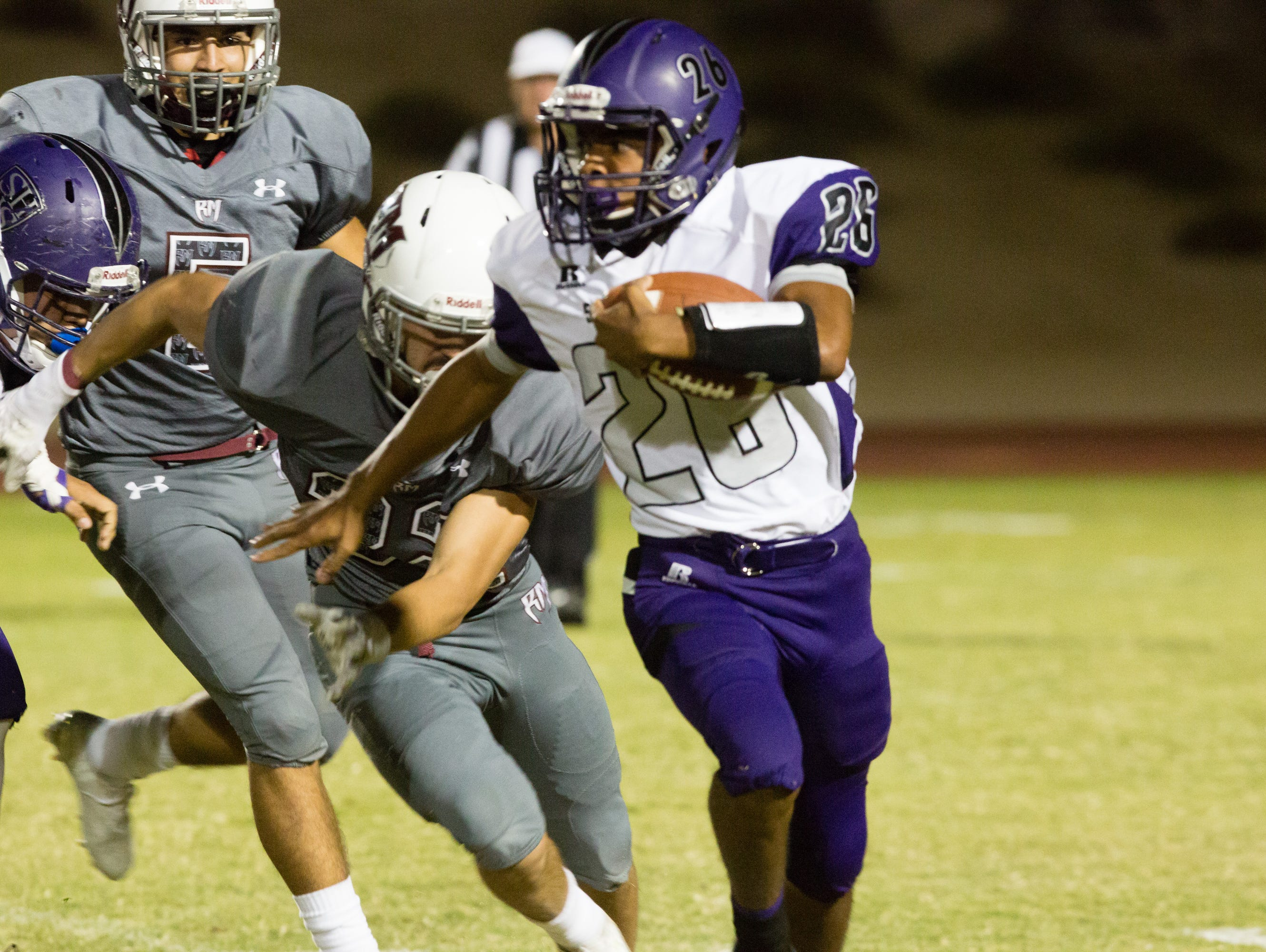 Lee Hawkins carries the ball for the Shadow Hills Knights, Friday, September 2, 2016.