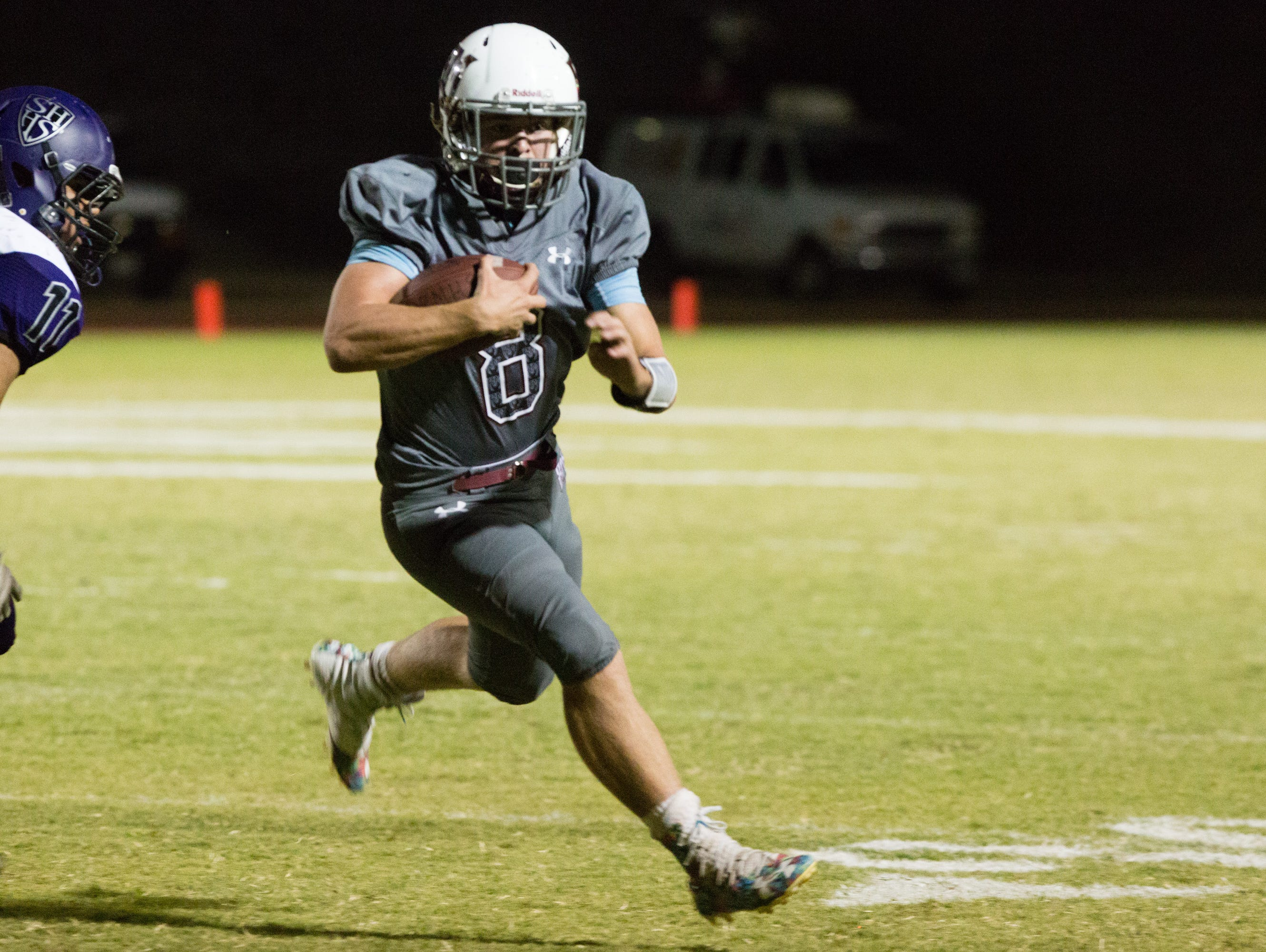 Kyle Whitefield runs the ball for a touchdown for Rancho Mirage, Friday, September 2, 2016.