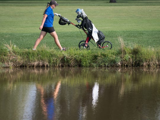 Jordann Handy of Oshkosh West walks down a fairway to her ball during a golf match Sept. 6, 2016, at Lakeshore Municipal Golf Course in Oshkosh.