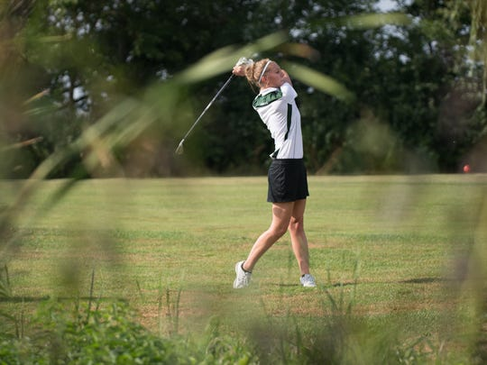 Sam Struensee of Oshkosh North hits from the fairway.