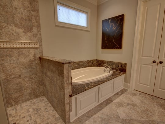 The master bath is large and luxurious just waiting