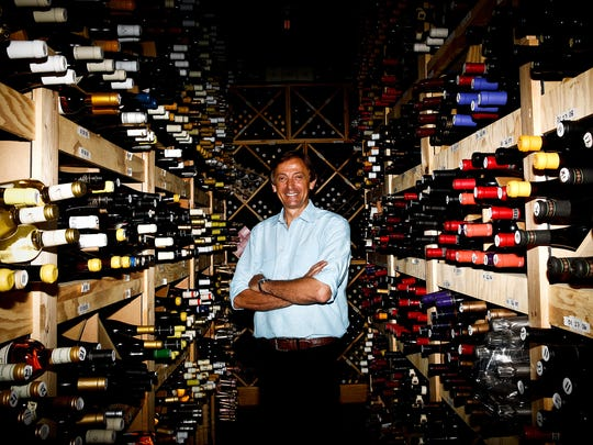 Jacques Cariot, who owns Bleu Provence alongside his wife and chef, Lysielle Cariot, poses in the restaurant's wine cellar in this Daily News file photo. This is the fourth consecutive year Bleu Provence has earned the Grand Award from Wine Spectator's list of restaurants with the best wine lists.