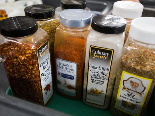 "A ""flavor station"" provides students with the option of adding spices or seasonings to their meals. Des Moines schools are cooking lunches with immigrants in mind by incorporating different 'flavor profiles' for various ethnic backgrounds."