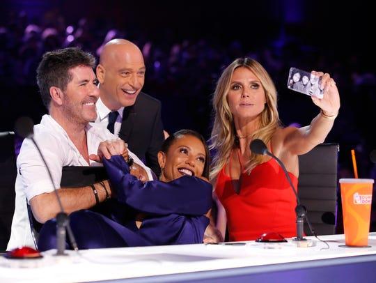 Simon Cowell, left, joins fellow 'America's Got Talent'