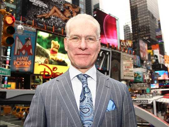 Tim Gunn poses for a photo while promoting the launch