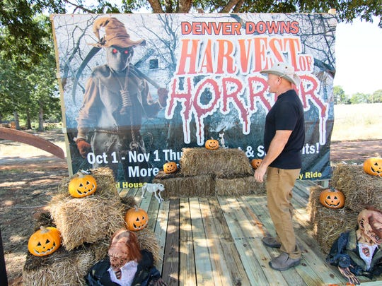 Ron Smith of Denver Downs looks at a stage for photos outside the Dark Harvest Penitentiary Haunted Prison on the farm in Anderson.