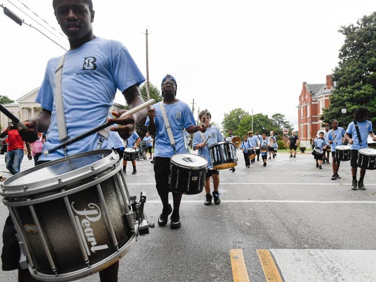 "The Evansville Boom Squad. Inc. drum line turns on to Washington Street in downtown Henderson as they participate in the first ""Yes We Can"" Diversity Parade Saturday, September 17, 2016."
