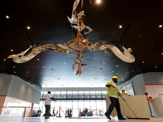 Workers finish sweeping the entry area of the Smithsonian's National Museum of African American History and Culture during the press preview on the National Mall September 14, 2016 in Washington, DC. Filled with exhibits and artifacts telling the story of the first Africans in the United States and their descendents, the 400,000-square-foot museum will open to the public on September 24.  (Photo by Chip Somodevilla/Getty Images)