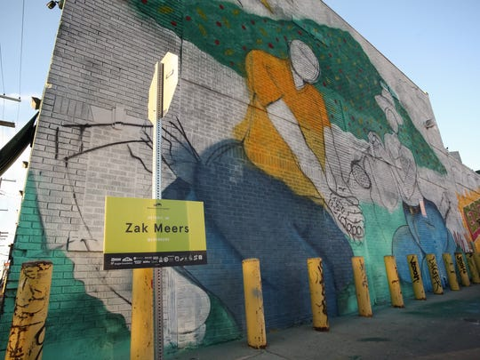 """Detroit artist Zak Meers used a farm to market theme in his contribution second annual """"Murals in the Market"""" festival."""