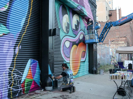 Work continues on murals by artists Patch Whisky and