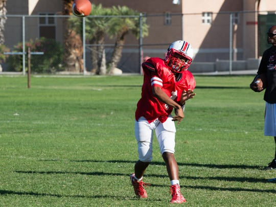 Jeremy Dotson practices with his team on Thursday, Sept. 22.  The sophomore quarterback helped Palm Springs win their first game of the season last Friday with 5 TD passes.