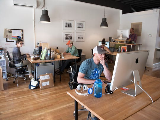 Casey Gold, a digital marketing strategist with Blue Ion, works out of Textile Hall in the village of West Greenville on Monday, October 3, 2016.