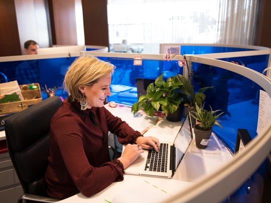 Ashley Brown, who runs her own advertising agency, works from her desk at Endeavor on Monday, October 3, 2016.