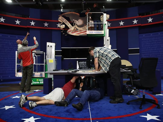 Workers assemble the set for the vice presidential
