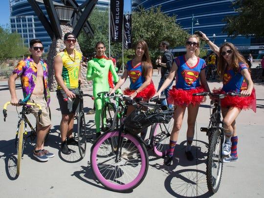 These superheros kept watch at Tour de Fat at Tempe