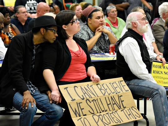 """Elijah Cross, left, and his wife Jessica Cross, both of York City, listen to speakers address the Council, residents and community members as they rally to oust Mayor Charles Wasko in light of racist behaviors during a Council Meeting in West York Borough, Monday, Oct. 3, 2016. The council would unanimously give directive to borough solicitor Mieke Driscoll to look into """"any means necessary"""" to remove Wasko as mayor. Dawn J. Sagert photo"""