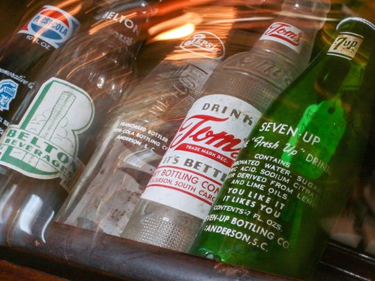 Bottles from Anderson and Belton, including from left an Anderson College commemorative (1974); Belton beverage; Pepsi and Tom's, both from the Terry Bottling Company in Anderson; and Seven-Up, are among the many for sale at the Old Depot Antique Mall on Murray Avenue in Anderson.