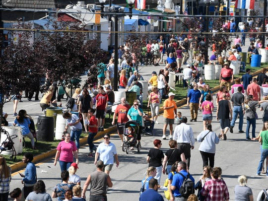 The lunch time crowd fills West Franklin Street for the Evansville West Side Nut Club Fall Festival Thursday, October 6, 2016