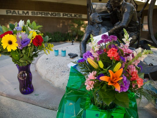 Residents light candles and place flowers at Palm Springs