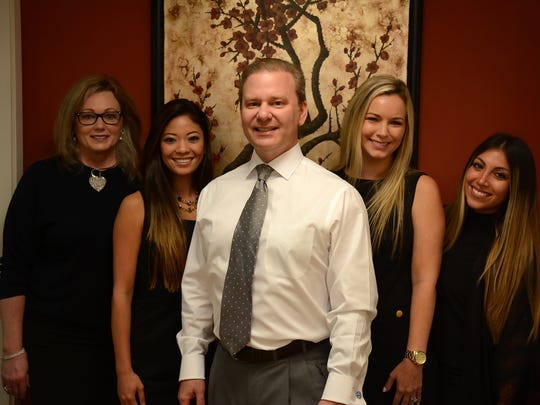 Dr. Scott Kareth with office manager Susan Cooper, from left, dental assistant Skye Reed, hygienist Natalie Sullivan and assistant  Andrea Romoleroux. Marco Island has a new dental practice, in the office at Royal Palm Mall that was known as Royal Palm Dentistry.