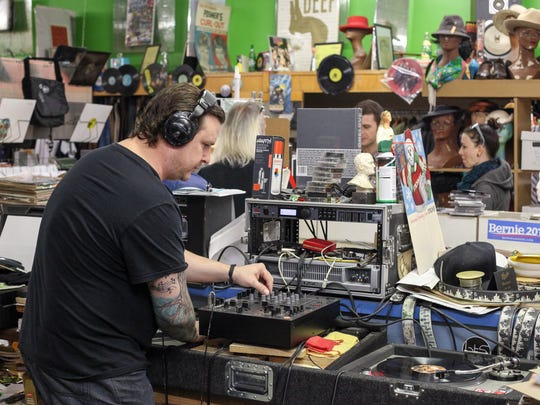 DJ John Clees, left, performs at Detroit Threads during the Hamtramck Neighborhood Arts Festival.