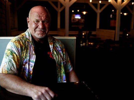 Best selling author Randy Wayne White stands for a portrait at Doc Ford's Sanibel Bar and Grill on Sanibel Island on Thursday, July 31, 2014. Scott McIntyre/Staff