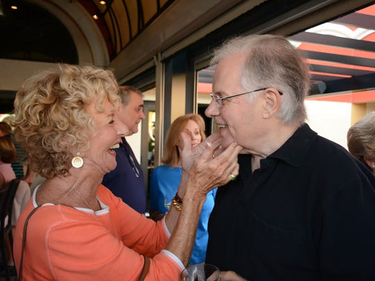 Don gets a kiss and a beard scratch from Judy Kenney. Friends of Don Farmer and Chris Curle, longtime broadcast journalists and Marco residents who are moving off the island, gathered at Marco Prime Monday evening to have a drink or two and wish them well.