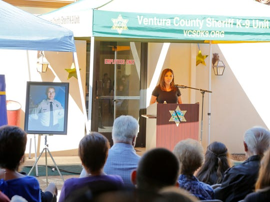 Gabi Aguirre Miramontes speaks in Ojai Friday during a highway sign unveiling to honor her late father, Deputy Peter J. Aguirre Jr.