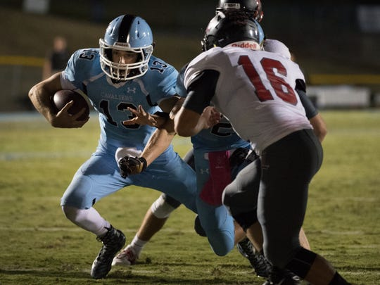 Christ ChurchÕs  Ellis Millwood (13) drives the ball towards the endzone at Christ Church Episcopal School on Friday, October 14, 2016.