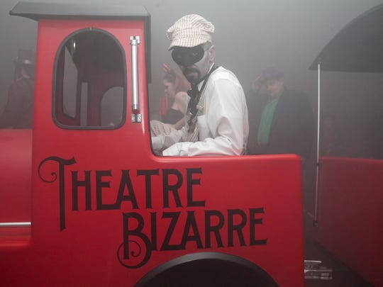 The Ghost Train takes guests on a fast-paced, foggy ride during the Theatre Bizarre masquerade ball.