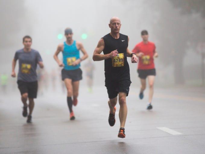 Runners run in the IMT Des Moines Marathon in Des Moines,